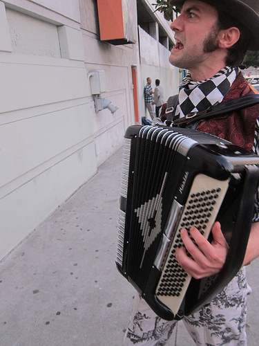 accordion player welcomes all